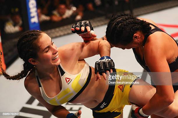 Veronica Macedo of Venezuela kicks facing Ashlee EvansSmith of the USA compete in their Womens Bantamweight Bout during the UFC Fight Night held at...