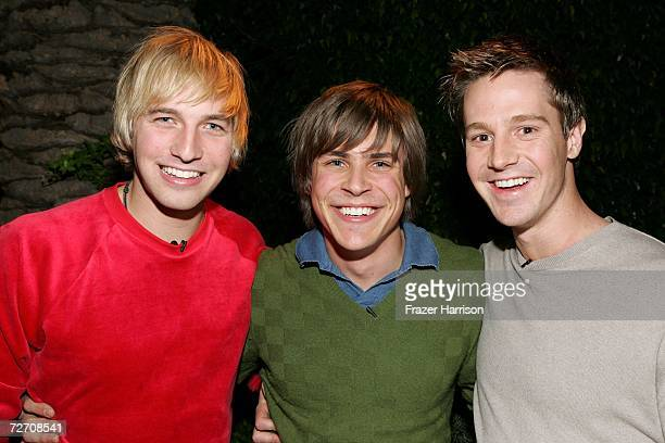 'Veronica Mars' cast members Ryan Hansen Chris Lowell and Jason Dohring pose backstage during the Church of Scientology's Christmas Stories XIV 'An...