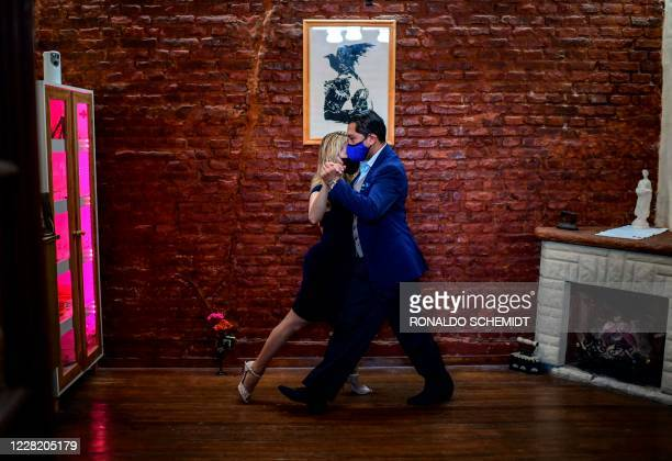 TOPSHOT Veronica Pascual and Sergio Saucet dance tango in their house in Buenos Aires on August 24 2020 Saucet and Pascual are competitors in the...