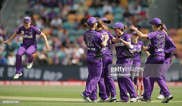 Veronica Pyke of the Hurricances celebrates with team mates after taking a catch to dismiss Jessica Jonassen of the Heat during the Women's Big Bash...