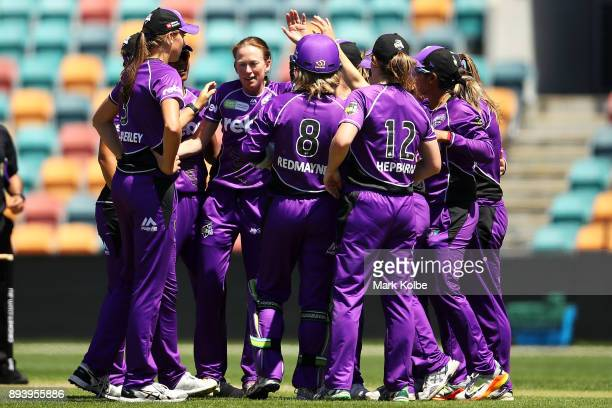 Veronica Pyke of the Hurricanes celebrates with her team after taking the wicket of Erin Burns of the Sixers during the Women's Big Bash League match...