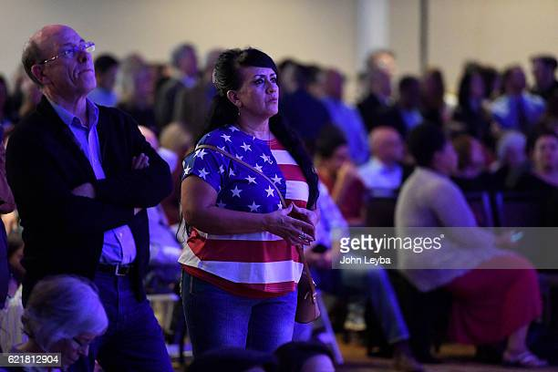 Veronica Rodriguez watches the returns on the big screen during a watch party November 8 2016 at the Westin on election night 2016