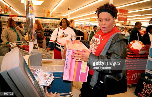 Veronica Scroggins attempts to use the selfserve checkout terminal in the Big KMart November 29 2002 in Bossier City Louisiana Scroggins hoping to...