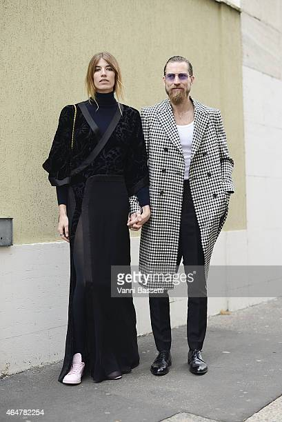 Veronika Heilbrunner and Justin O'Shea poses after Just Cavalli show on February 28 2015 in Milan Italy
