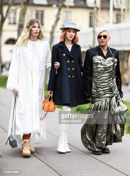 Veronika Heilbrunner, Irene Kim and Bryan Boy are seen outside the Loewe show during Paris Fashion Week: AW20 on February 28, 2020 in Paris, France.