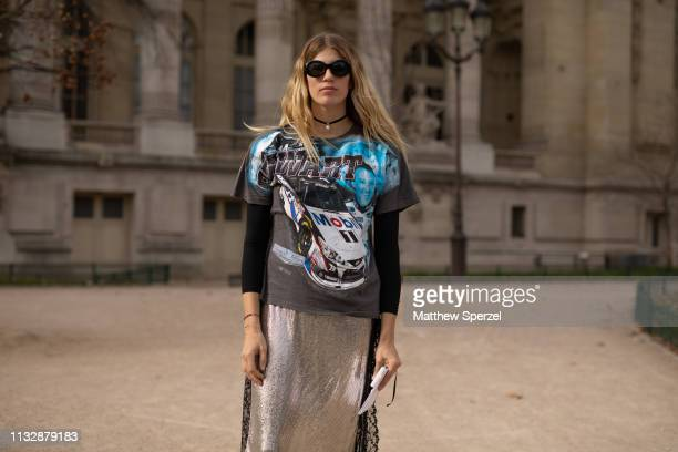 Veronika Heilbrunner is seen on the street attending Paco Rabanne during Paris Fashion Week AW19 wearing Nascar tshirt with silver skirt on February...