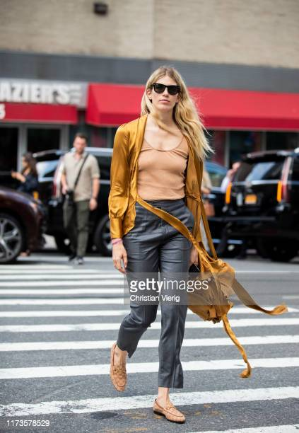 Veronika Heilbrunner is seen wearing mustard kimono, grey pants outside Zimmermann during New York Fashion Week September 2019 on September 09, 2019...