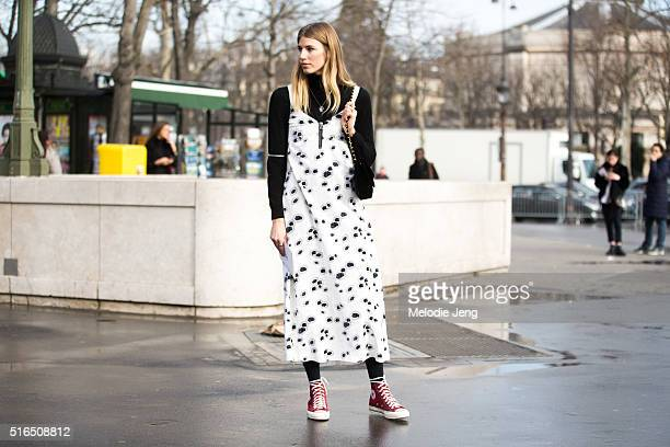 Veronika Heilbrunner of Hey Woman wears a Ellery slip print dress Chanel purse and red Converse sneakers at the Chanel show at Grand Palais on March...