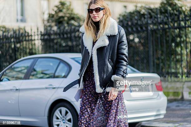 Veronika Heilbrunner wearing a black Acne shearling leather jacket and a purple dress with a floral printoutside Dries van Noten during the Paris...
