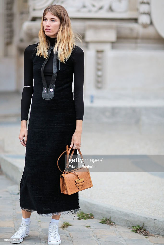 Veronika Heilbrunner wearing a Calvin Klein dress, a Loewe bag and Converse shoes after the Akris show during the Paris Fashion Week SS16 on October 4, 2015 in Paris, France.