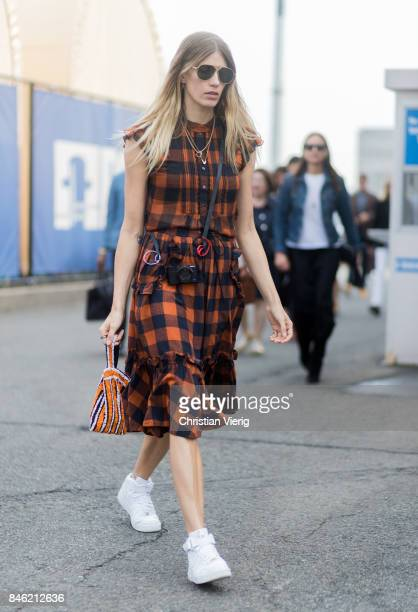 Veronika Heilbrunner wearing a checked dress seen in the streets of Manhattan outside Coach during New York Fashion Week on September 12 2017 in New...