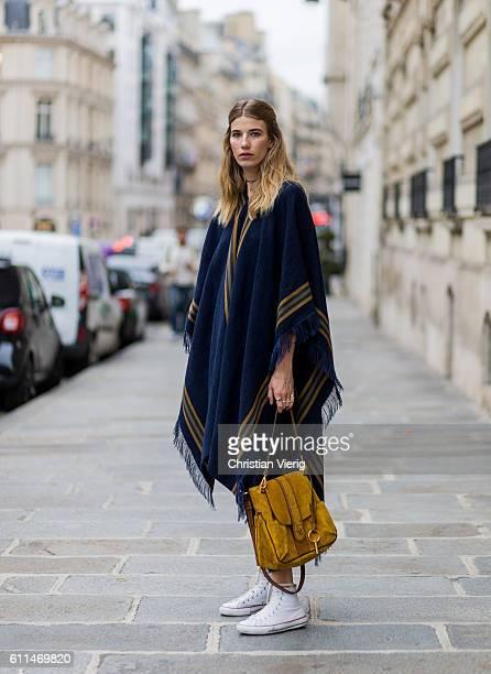 Veronika Heilbrunner wearing a Chloe poncho, Chloe Lexa bag and Converse sneaker outside Chloe on September 29, 2016 in Paris, France.