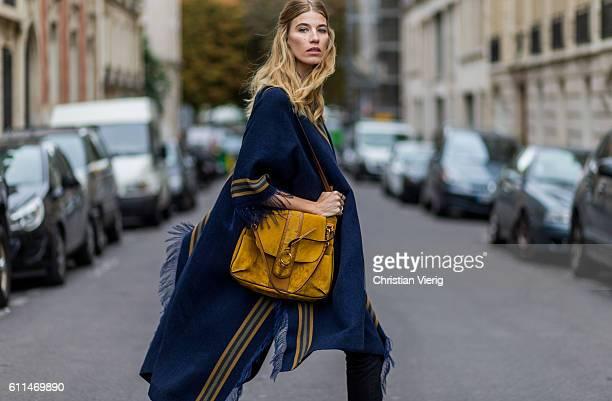 Veronika Heilbrunner wearing a Chloe poncho Chloe Lexa bag and Converse sneaker outside Chloe on September 29 2016 in Paris France