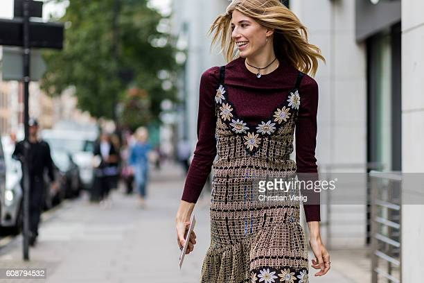 Veronika Heilbrunner wearing a dress and jumper outside during London Fashion Week Spring/Summer collections 2017 on September 19 2016 in London...