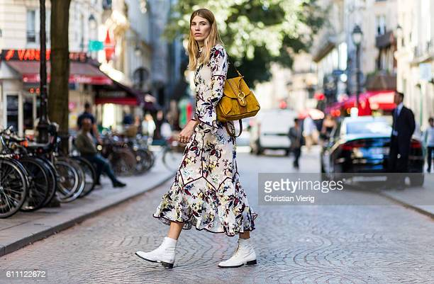 Veronika Heilbrunner wearing a dress with floral print and a Chloe Lexa bag on September 28 2016 in Paris France