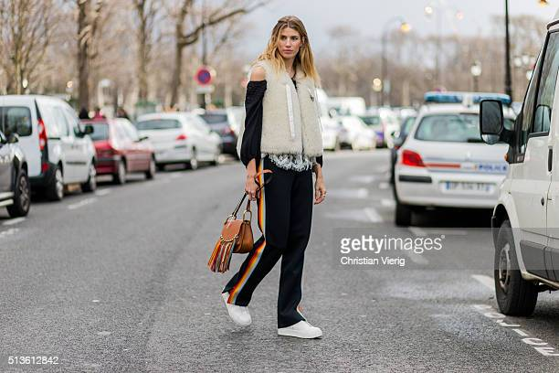 Veronika Heilbrunner wearing a fur vest Chloe bag and black jogger pants and white sneaker outside Chloe during the Paris Fashion Week Womenswear...