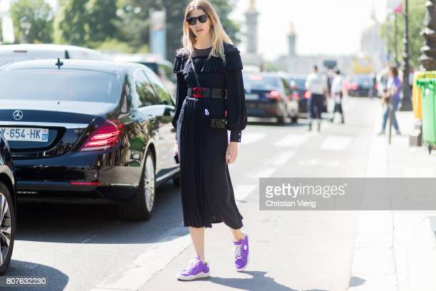 Veronika Heilbrunner wearing a navy dress Chanel belt and Chanel backpack outside Chanel during Paris Fashion Week Haute Couture Fall/Winter 20172018...