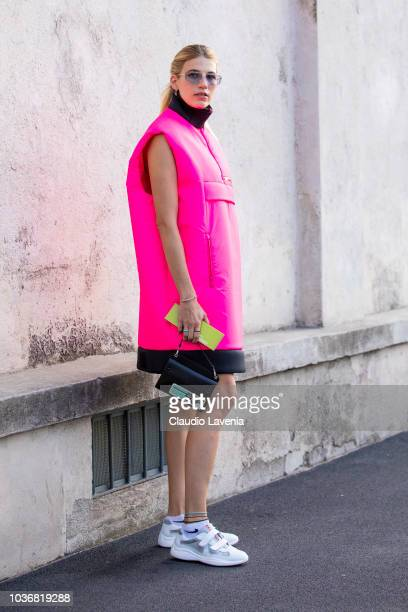 Veronika Heilbrunner wearing a neon fuchsia jacket is seen in the streets of Milano before the Prada show during Milan Fashion Week Spring/Summer...