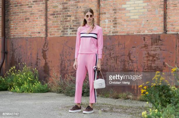 Veronika Heilbrunner wearing a pink suit outside Ganni on August 10 2017 in Copenhagen Denmark
