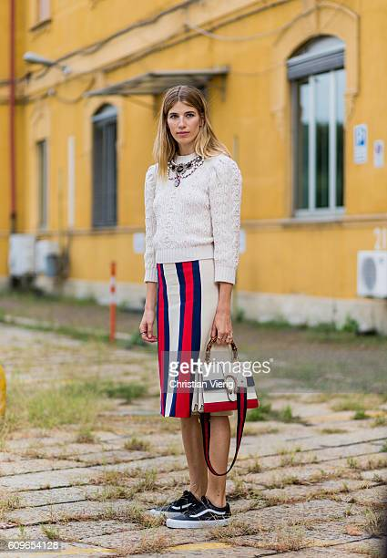 Veronika Heilbrunner wearing a striped skirt Vans and Gucci bag and sweater is seen outside Gucci during Milan Fashion Week Spring/Summer 2017 on...