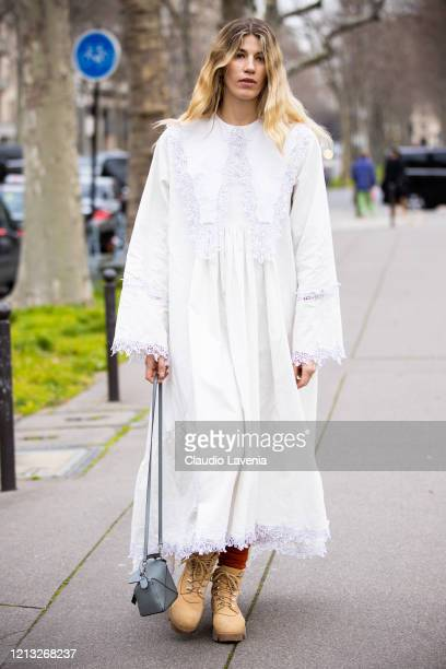 Veronika Heilbrunner, wearing a white decorated dress, beige boots and grey bag, is seen outside Loewe, during Paris Fashion Week - Womenswear...
