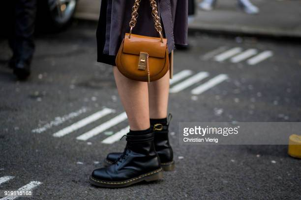 Veronika Heilbrunner wearing black dress, Chloe bag, boots seen outside Mulberry during London Fashion Week February 2018 on February 16, 2018 in...