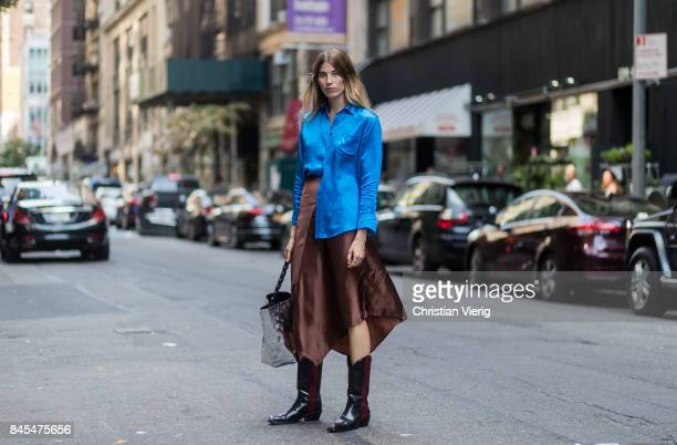 Veronika Heilbrunner wearing blue button shirt brown skirt cowboy boots seen in the streets of Manhattan outside Sies Marjan during New York Fashion...