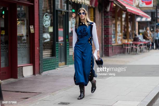 Veronika Heilbrunner wearing blue dress outside JW Anderson during London Fashion Week September 2017 on September 16 2017 in London England