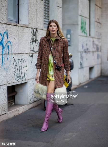 Veronika Heilbrunner wearing checked coat is seen outside Prada during Milan Fashion Week Spring/Summer 2018 on September 21 2017 in Milan Italy