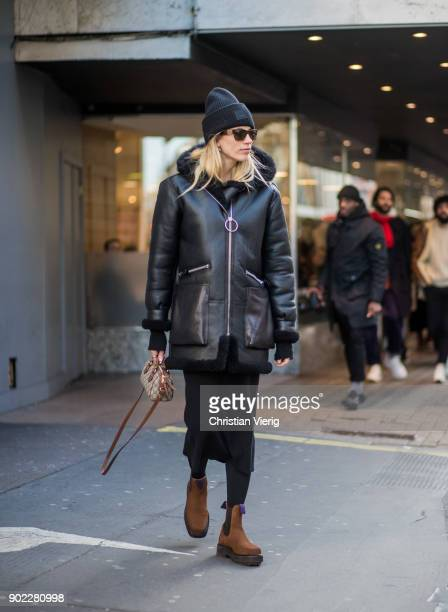 Veronika Heilbrunner wearing Gucci mini bag Acne beanie leather jacket midi skirt brown boots during London Fashion Week Men's January 2018 on...