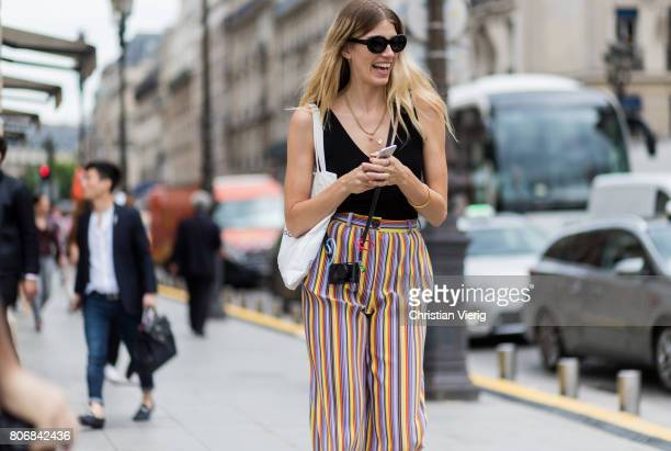 Veronika Heilbrunner wearing striped pants outside Schiaparelli during Paris Fashion Week Haute Couture Fall/Winter 20172018 Day Two on July 3 2017...