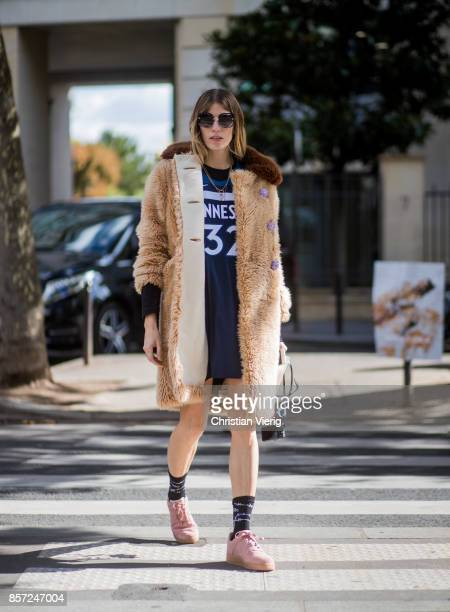 Veronika Heilbrunner wearing teddy coat football jersey seen outside Miu Miu during Paris Fashion Week Spring/Summer 2018 on October 3 2017 in Paris...