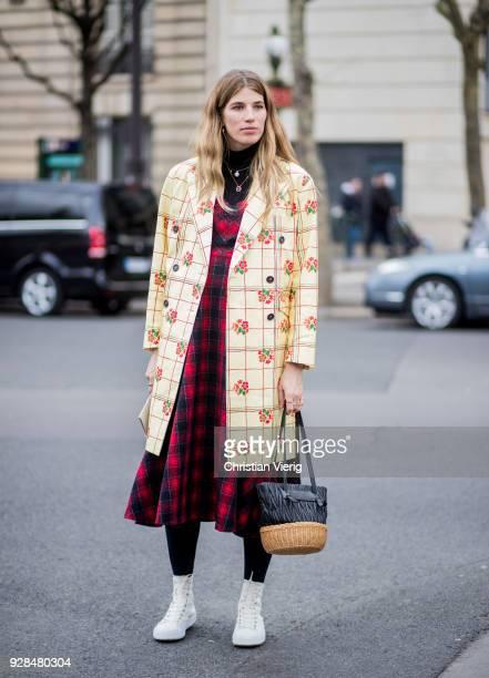 Veronika Heilbrunner wearing yellow plaid coat red black tartan dress is seen outside Miu Miu during Paris Fashion Week Womenswear Fall/Winter...