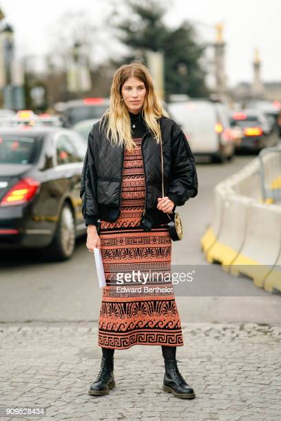 Veronika Heilbrunner wears a black bomber jacket a dress boots outside Chanel during Paris Fashion Week Haute Couture Spring/Summer 2018 on January...