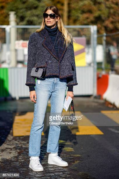 Veronika Heilbrunner wears a blazer jacket blue pants white shoes outside Chanel during Paris Fashion Week Womenswear Spring/Summer 2018 on October 3...