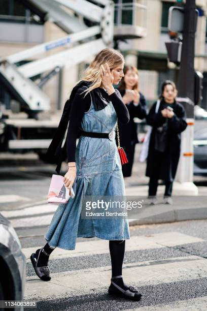 Veronika Heilbrunner wears a blue denim skirt a belt outside Miu Miu during Paris Fashion Week Womenswear Fall/Winter 2019/2020 on March 05 2019 in...