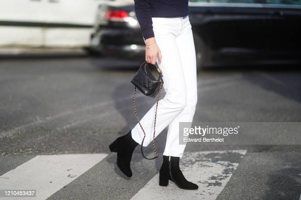 Veronika Heilbrunner wears a blue pullover white pants black pointy shoes a quilted bag outside Lacoste during Paris Fashion Week Womenswear...