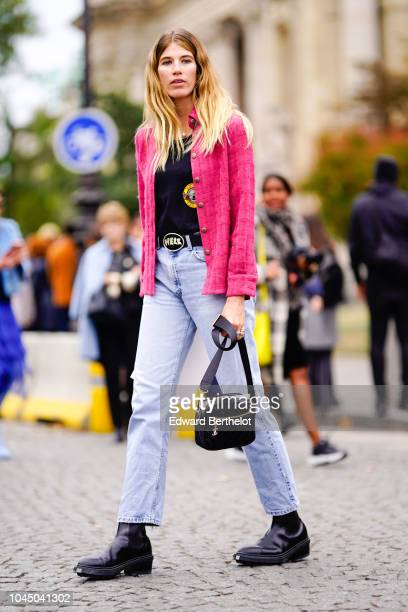Veronika Heilbrunner wears a pink tweed jacket blue pants a bag outside Chanel during Paris Fashion Week Womenswear Spring/Summer 2019 on October 2...
