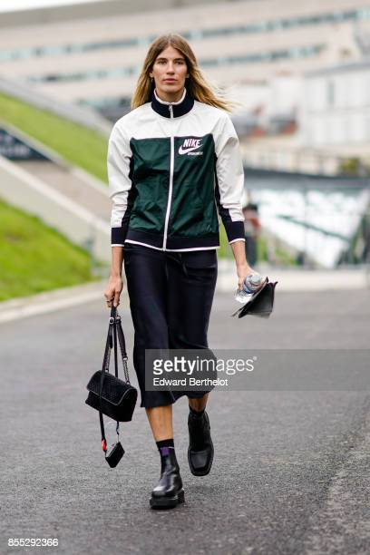 Veronika Heilbrunner wears a sportswear jacket outside Ann Demeulemeester during Paris Fashion Week Womenswear Spring/Summer 2018 on September 28...