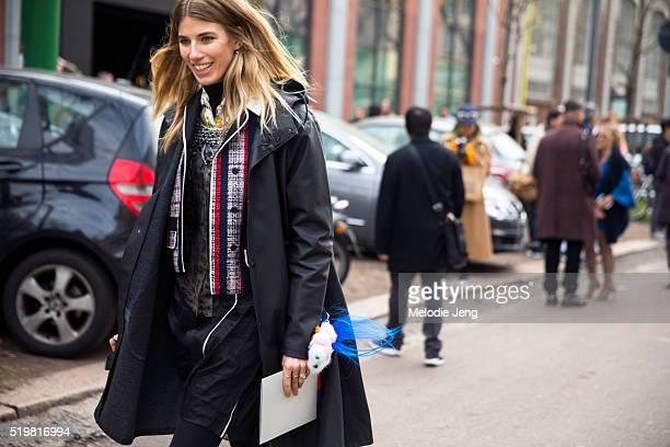 Veronika Heilbrunner wears a Stutterheim rain jacket and a Prada top at the Fendi show during the Milan Fashion Week Fall/Winter 2016/17 on February...