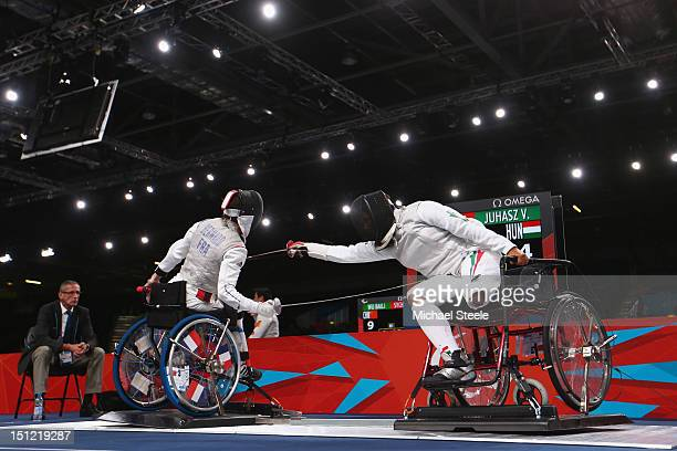 Veronika Juhasz of Hungary and Delphine Bernard of France compete during the Women's Individual Foil Cat A Preliminaries of the Wheelchair Fencing on...