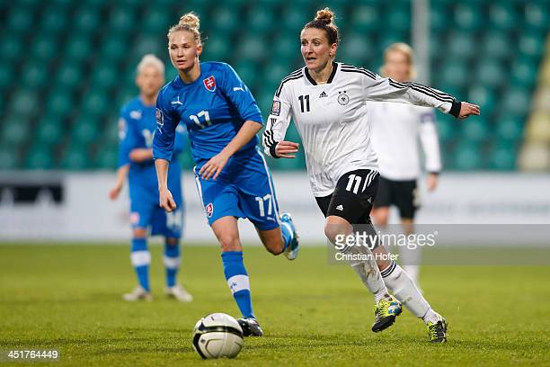 Veronika Klechova of Slovakia competes for the ball with Anja Mittag of Germany during the FIFA Women's World Cup 2015 Qualifier between Slovakia and...