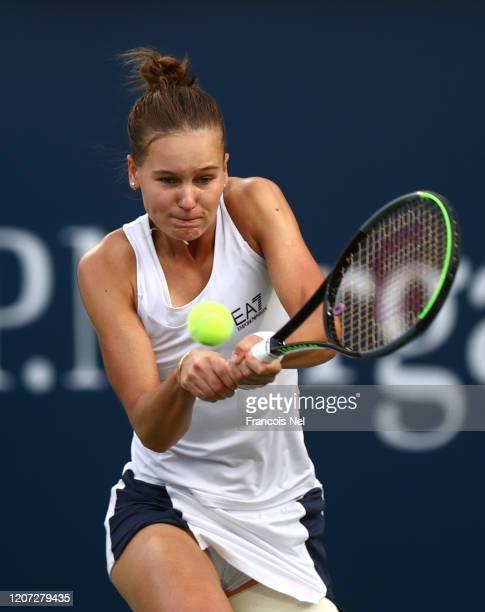 Veronika Kudermetova of Russia plays a backhand against Garbine Muguruza of Spain during Day Three of the Dubai Duty Free Tennis at Dubai Duty Free...