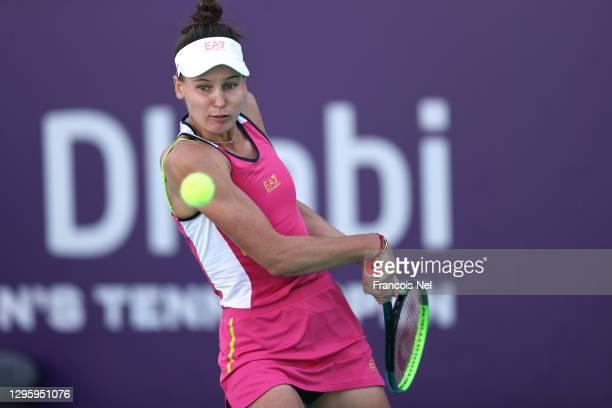 Veronika Kudermetova of Russia plays a backhand against Marta Kostyuk of Ukraine during her women's singles semi final match on Day Seven of the Abu...