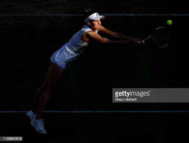 Veronika Kudermetova of Russia plays a backhand in her Ladies' Singles second round match against Caroline Wozniacki of Denmark during Day three of...