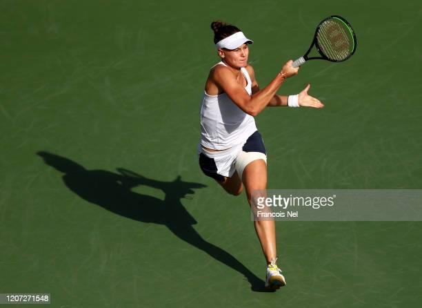 Veronika Kudermetova of Russia plays a forehand against Garbine Muguruza of Spain during Day Three of the Dubai Duty Free Tennis at Dubai Duty Free...