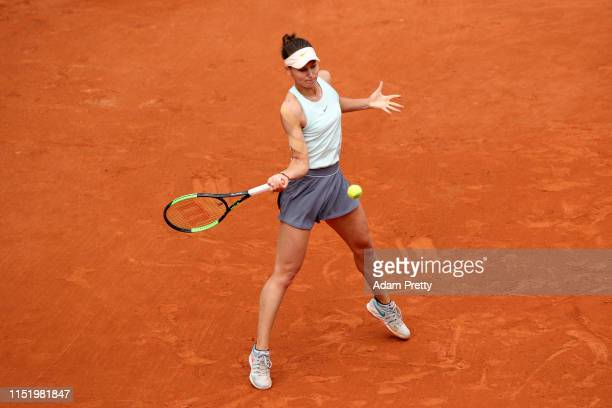 Veronika Kudermetova of Russia plays a forehand during her ladies singles first round match against Caroline Wozniacki of Denmark during Day two of...