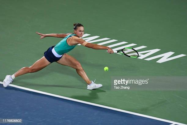Veronika Kudermetova of Russia returns a shot during the match against Belinda Bencic of Switzerland on Day 3 of 2019 Dongfeng Motor Wuhan Open at...