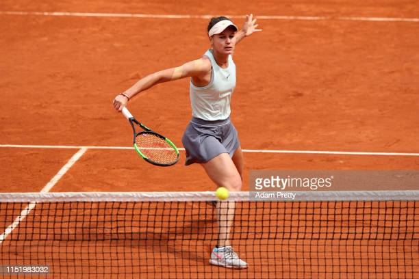 Veronika Kudermetova of Russia volleys during her ladies singles first round match against Caroline Wozniacki of Denmark during Day two of the 2019...