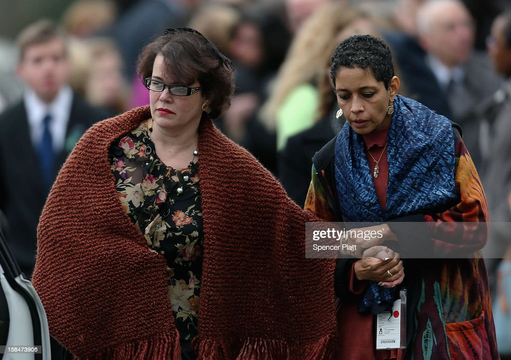 Veronika Pozner (L) leaves the funeral services for her six year-old son Noah Pozner, who was killed in the shooting massacre in Newtown, CT, at Abraham L. Green and Son Funeral Home on December 17, 2012 in Fairfield, Connecticut. Today is the first day of funerals for some of the twenty children and seven adults who were killed by 20-year-old Adam Lanza on December 14, 2012.